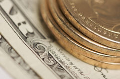 Monedas y cuentas abstractas del dólar de los E.E.U.U. Imagen de archivo libre de regalías