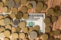 Monedas y dólares Imagen de archivo