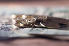 Monedas y dólares Fotografía de archivo libre de regalías