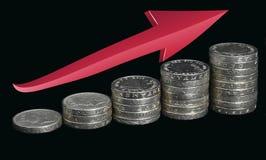 """Monedas y flecha del †cada vez mayor de los beneficios """" foto de archivo"""