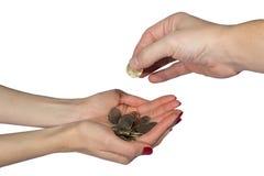 Monedas y mano en el fondo blanco Fotografía de archivo