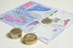 Monedas y Pesos de Argentina fotos de archivo libres de regalías