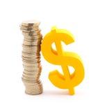Monedas y símbolo del dólar Imagen de archivo libre de regalías