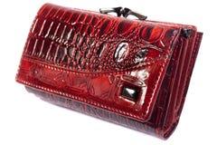 Monedero brillante rojo aislado. Fotos de archivo