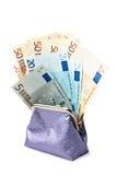 Monedero con el dinero aislado en el blanco (camino incluido) Foto de archivo libre de regalías