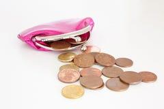 Monedero con las monedas foto de archivo