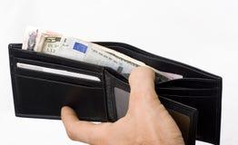 Monedero con un dinero Foto de archivo