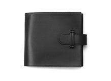 Monedero de cuero negro Fotografía de archivo libre de regalías