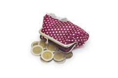 Monedero hermoso con las monedas aisladas en blanco Imagenes de archivo