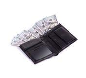 Monedero por completo con los billetes de dólar Imagenes de archivo