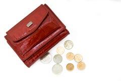 Monedero rojo con las monedas Imágenes de archivo libres de regalías