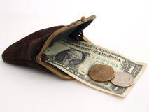 Monedero viejo con dos dólares, en un fondo blanco Foto de archivo libre de regalías