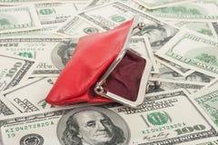 Monedero y dólares Fotografía de archivo libre de regalías