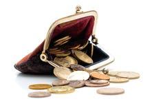 Monedero y monedas aislados Imagenes de archivo