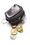 Monedero y monedas de cuero imagenes de archivo