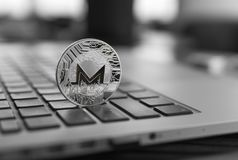 Monero coin symbol on laptop, future concept financial currency, crypto currency sign. Blockchain mining. Digital money. And virtual cryptocurrency concept stock photos