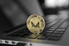 Monero coin symbol on laptop, future concept financial currency, crypto currency sign. Blockchain mining. Digital money. And virtual cryptocurrency concept royalty free stock image
