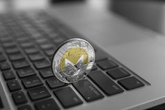 Monero coin symbol on laptop, future concept financial currency, crypto currency sign. Blockchain mining. Digital money. And virtual cryptocurrency concept stock image