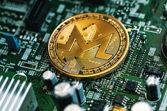 Monero cryptocurrency coin. On a computer chip Stock Photo
