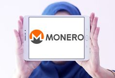 Monero cryptocurrency logo. Logo of Monero cryptocurrency on samsung tablet holded by arab muslim woman. Monero , XMR , is an open-source cryptocurrency that Stock Photos