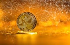 Monero cryptocurrency på en guld- bakgrund Arkivbilder
