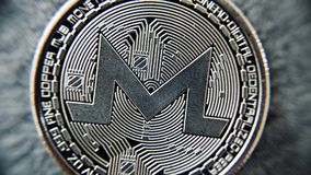 Monero - silver coin. Digital currency physical metal silver monero coin. Monero closeup concept stock photography