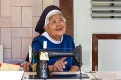 Monestery Saint Franciscus in Semarang. Semarang, Indonesia - November, 01, 2017:  A catholic sister behind a sewing machine in Monastery Saint Franciscus in Royalty Free Stock Image