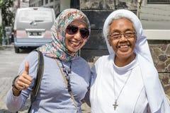 Monestery Saint Franciscus in Semarang. Semarang, Indonesia - November, 01, 2017:  A muslim woman and a catholic sister happy together in  Monastery Saint Royalty Free Stock Photos