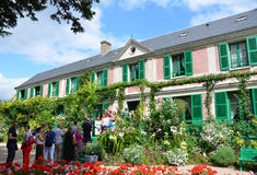 Monet house, Giverny, France. GIVERNY, FRANCE - AUG 5:  Tourists wait to enter the home of Claude Monet from his garden in Giverny, France, is shown here on Stock Photography