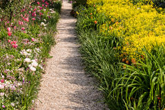 Monet's Garden Path. A walkway in Monet's garden, Giverny, France. A colorful symbol of adventure and exploraton Stock Photo