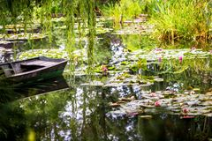 Monet`s Gardens and lake with water lilies at Giverny, Normandy, France stock photos