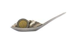 Moneta con il cucchiaio Fotografia Stock
