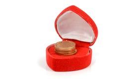 Moneta in contenitore di regalo Immagine Stock