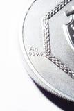 Moneta d'argento su un fondo bianco Fotografia Stock