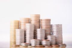 Moneta dei soldi della pila per la coltura del vostro affare immagine stock