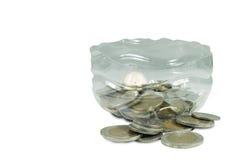 Moneta di attività bancarie in bottiglia Fotografia Stock