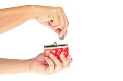 Moneta di lancio della mano in borsa Fotografie Stock Libere da Diritti
