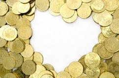 Moneta di oro con forma del cuore Immagine Stock