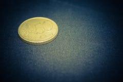 Moneta dorata Immagini Stock