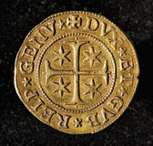 Moneta dorata antica Immagini Stock