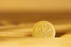 Moneta dorata antica Fotografia Stock