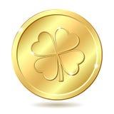 Moneta dorata con il trifoglio. Fotografia Stock