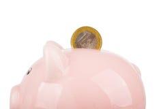 Moneta e porcellino salvadanaio Immagini Stock Libere da Diritti
