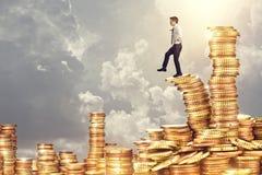 Moneta ed uomo dorati Immagini Stock Libere da Diritti