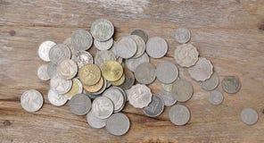 Moneta nella tavola Fotografia Stock Libera da Diritti