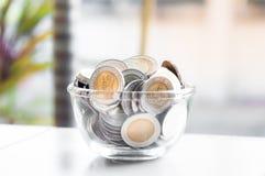 Moneta pieniądze w szklanym słoju obrazy royalty free
