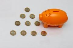 Moneta rupie da dieci e del porcellino salvadanaio dell'India Immagini Stock Libere da Diritti