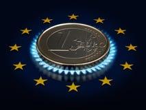 Moneta una EURO e una bandierina di Unione Europea. Immagine Stock