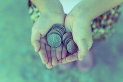Moneta w dziecko ręce Biznes Obraz Stock