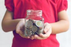 Moneta w dziecko ręce Biznes Fotografia Stock